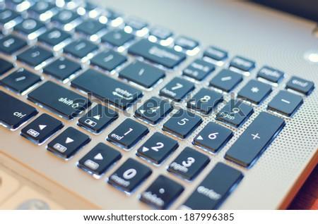 laptop keyboard numbers light - stock photo