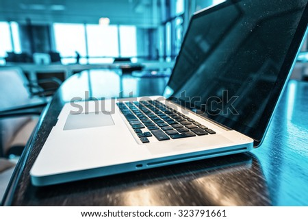 Laptop keyboard on a modern office interior. - stock photo