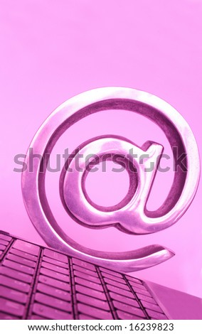 Laptop keyboard with arroba symbol at the end - stock photo