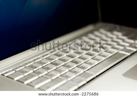 Laptop Keyboard with blue lcd screen Shallow Depth of field