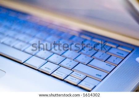 Laptop Keyboard with blue light from lcd - stock photo