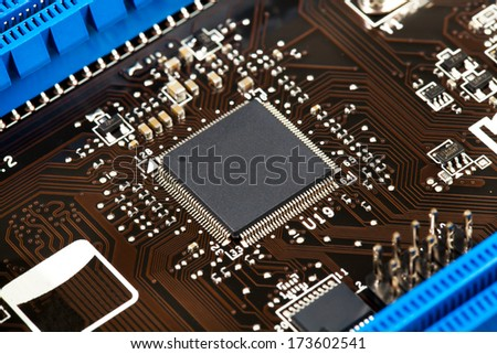 Laptop microchip on motherboard closeup - stock photo