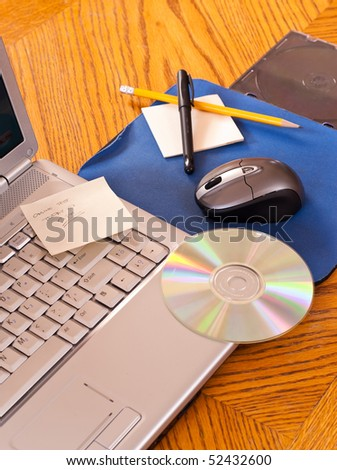 Laptop Mouse and Computer with CD - stock photo