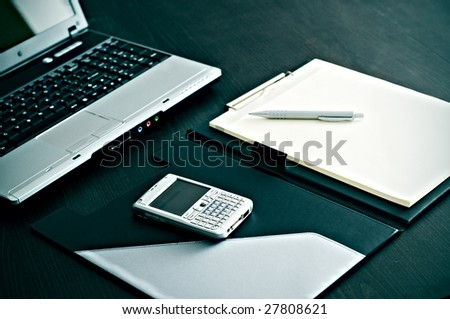 Laptop,notebook,and mobile phone on office desk