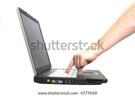 Laptop notebook isolated on white with hand pressing button