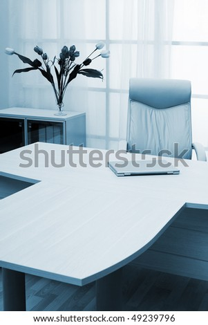 laptop on a table of director at modern office - stock photo