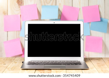 laptop on a wooden table background Notepad. - stock photo