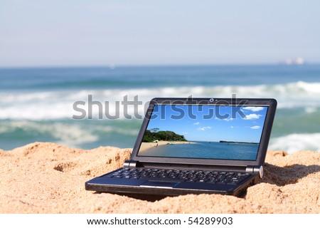 laptop on beach - stock photo