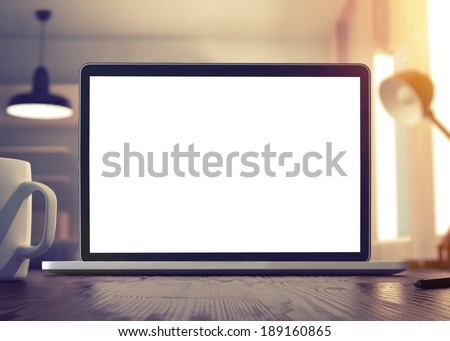 Laptop on table - stock photo