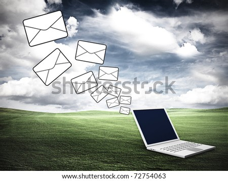 Laptop on the lawn. Communication concept. - stock photo