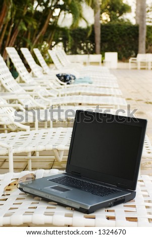 Laptop on vacation - stock photo