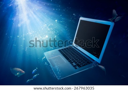 laptop on water/ damaged computer - stock photo