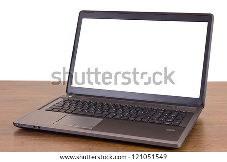 laptop on white background and wooden table - stock photo