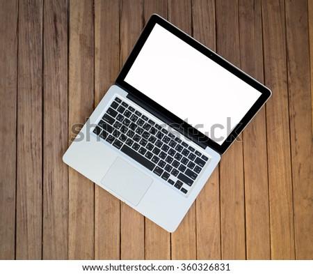 Laptop on wood table - stock photo