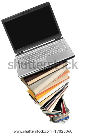 Laptop over books stack isolated over white background - stock photo