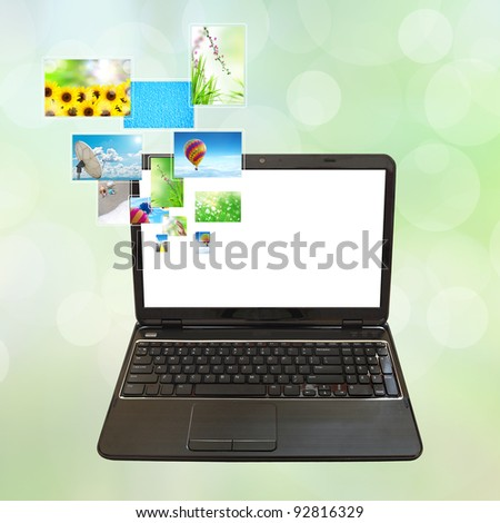 laptop PC and streaming images virtual buttons - stock photo