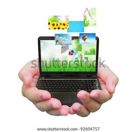 laptop PC and streaming images virtual buttons on women hand - stock photo