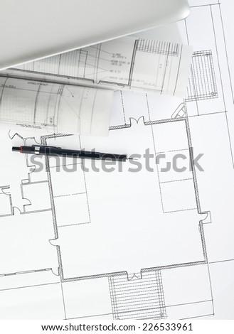 Laptop, pencil and blueprints - stock photo