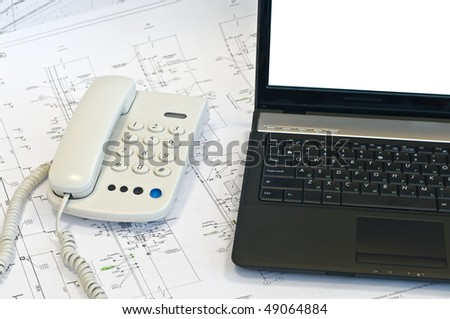 Laptop, phone on project drawings. Working place. White screen - stock photo