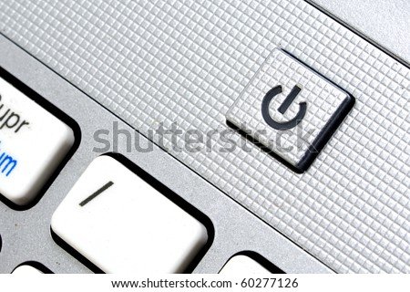 Laptop power key with metallic finish - stock photo