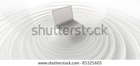 Laptop sending wireless waves - stock photo