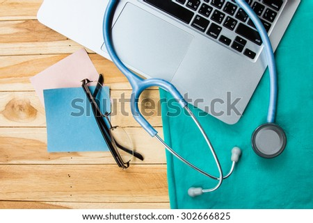 laptop, stethoscope, medicine and therapy,eyeglasses,notepad, background - stock photo