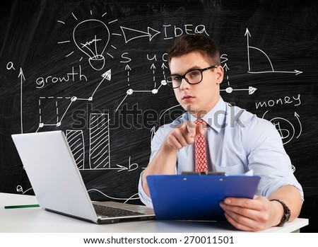 Laptop. Student working on laptop in library - stock photo