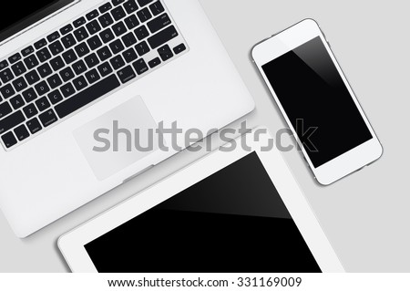 Laptop tablet and smartphone on white table background with text space and copy space, Responsive Web Design - stock photo
