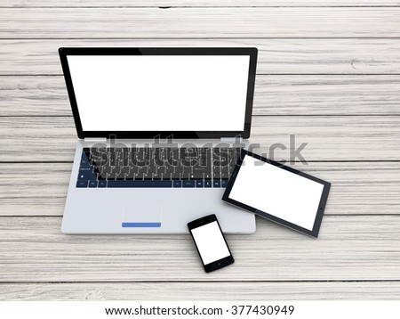 Laptop, tablet and smartphone on wood background - stock photo
