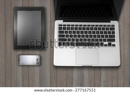 Laptop tablet computer with    and cup of coffee on grass Simple workspace or coffee break with web surfing. - stock photo