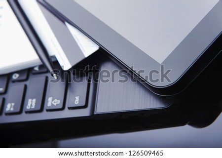 Laptop, tablet, notebook and credit card for payment online