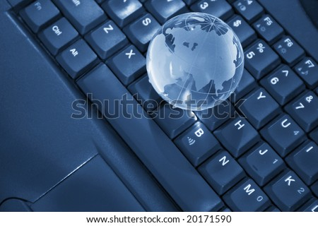laptop with a globe on it, internet concept