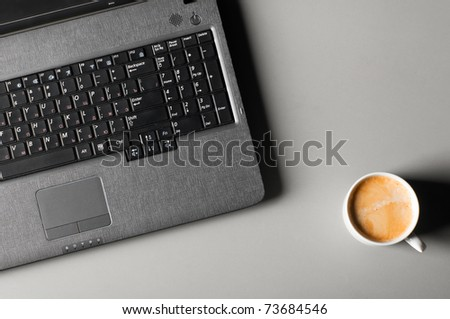 laptop with fresh cup of coffee, view from above - stock photo