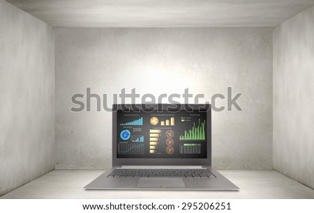 Laptop with graphs and diagrams on screen - stock photo