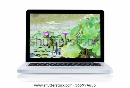 Laptop with landscape present monitor on over white background