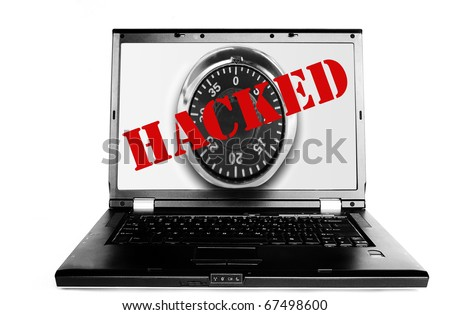 "Laptop with lock and red ""Hacked"" text - stock photo"