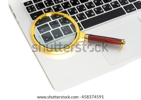 Laptop With Magnifying Glass on white - stock photo