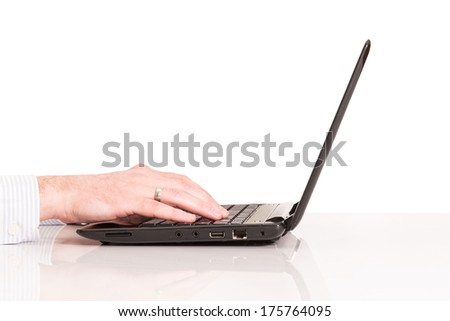laptop with man hand isolated on white background  - stock photo