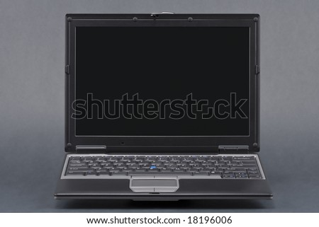 Laptop with path for laptop and a seperate path for the screen. Isolated on a black background. - stock photo