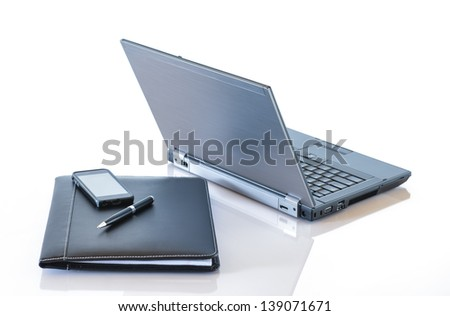 Laptop with Portfolio, Phone, and Pen - stock photo