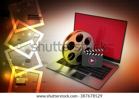 Laptop with reel wheel and clap board in color background - stock photo