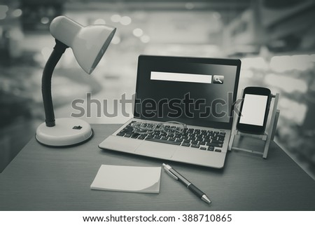 laptop with search engine screen on table ,blur store background