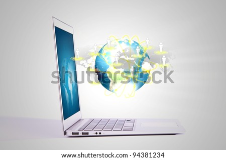 Laptop with social network on earth - stock photo