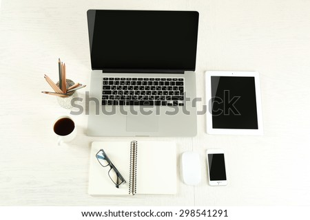 Laptop with tablet and smart phone on Workplace top view - stock photo