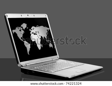 laptop with world map on black background - stock photo