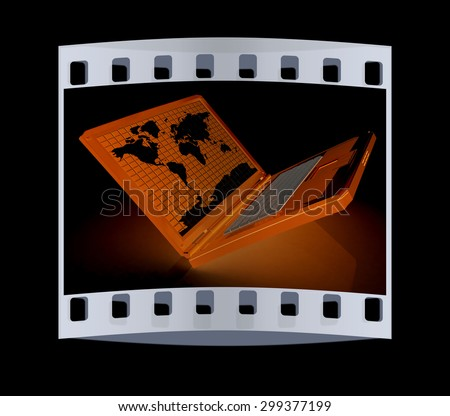 Laptop with world map on screen on a black background. The film strip - stock photo