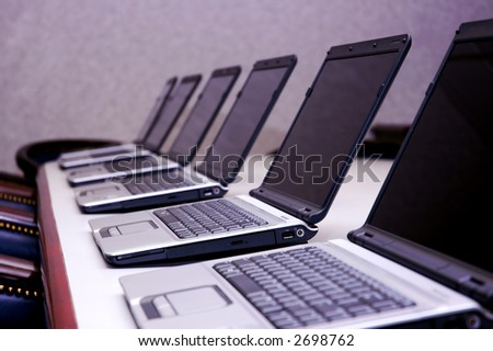 Laptops on Conference Table - stock photo