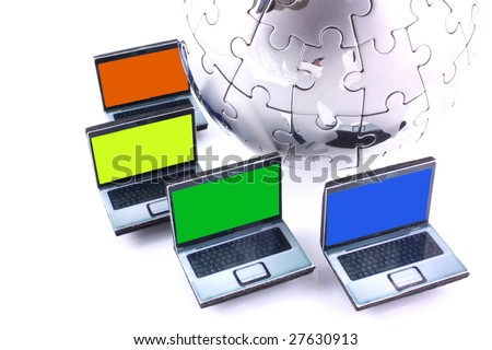 Laptops with one colour screens around a chrome jigsaw globe