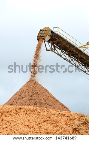 Larch wood chip processing facility piling up chips to be loaded on a ship for export in Coos Bay Oregon