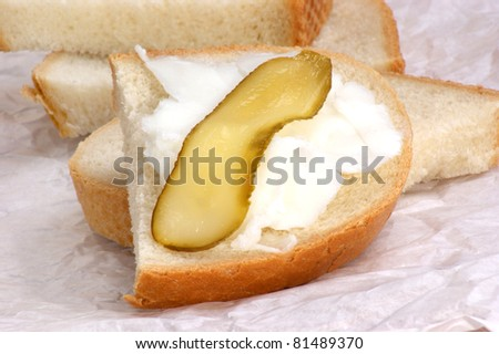 Lard with gherkin on home baked bread